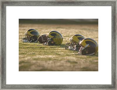 Helmets In Golden Dawn Sunlight Framed Print