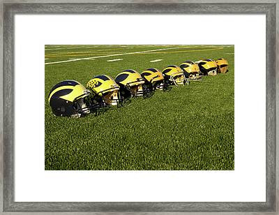 Helmets Of Different Eras On The Field Framed Print