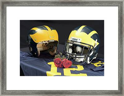 Helmets Of Different Eras With Jersey And Roses Framed Print