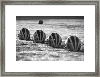 Helmets On Dew-covered Field At Dawn Black And White Framed Print