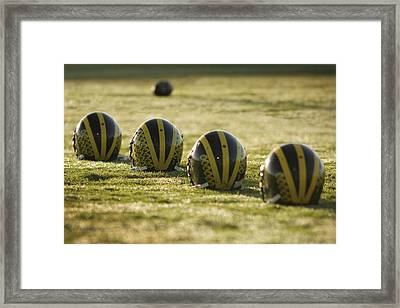Helmets On Dew-covered Field At Dawn Framed Print