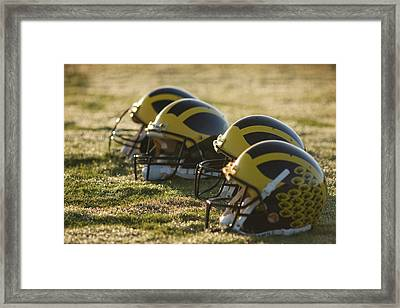 Helmets On The Field At Dawn Framed Print