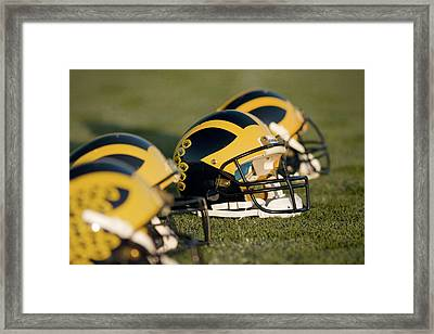 Helmets On The Field Framed Print