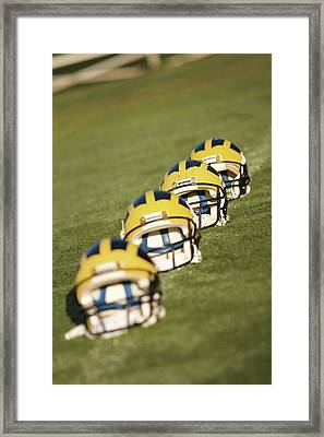Helmets On Yard Line Framed Print