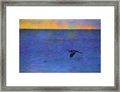 Framed Print featuring the photograph Heron Across The Sea by Jan Amiss Photography