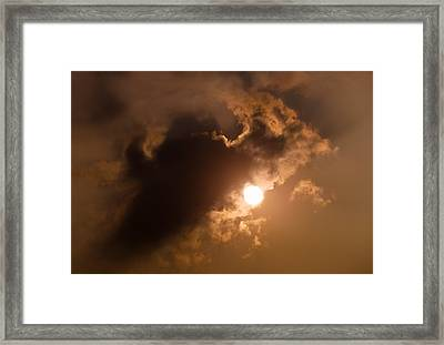 Hiding Behind The Clouds Framed Print by Wim Lanclus