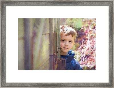 Hiding Behind The Wagon Framed Print