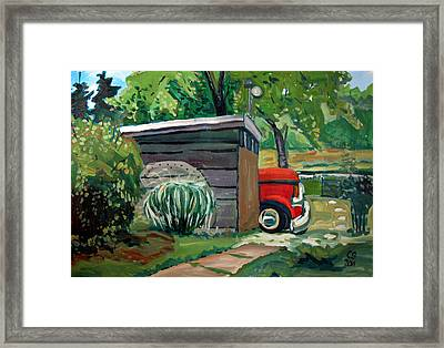 Hiding From The Junkyard Framed Print
