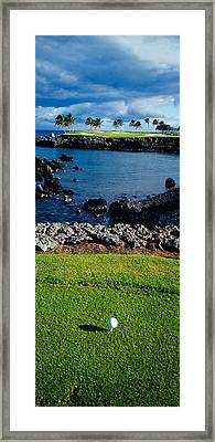 High Angle View Of A Golf Ball On A Tee Framed Print