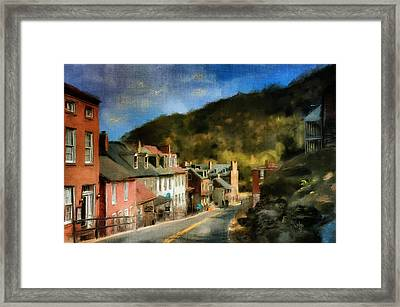 High Street In The Early Evening Framed Print by Lois Bryan