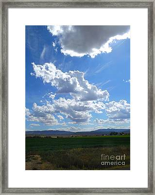 High Winds Chase The Rain Clouds Away Framed Print by Annie Gibbons