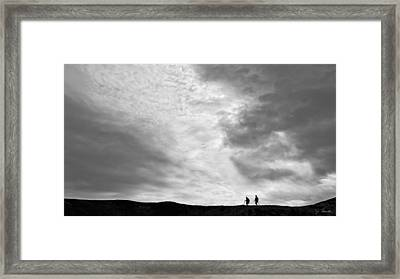 Framed Print featuring the photograph Hikers Under The Clouds by Joe Bonita