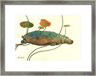 Hippo Swimming With Water Lilies Framed Print by Juan  Bosco