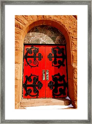 Historic Church Doors Framed Print by Sonja Anderson