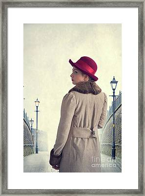 Framed Print featuring the photograph Historical Woman In An Overcoat And Red Hat by Lee Avison