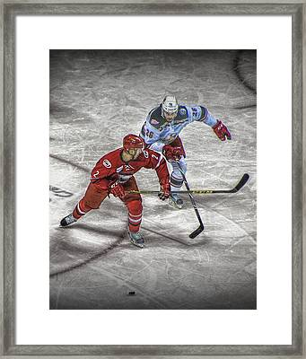 Hockey Players Battling It Out Over The Puck Framed Print