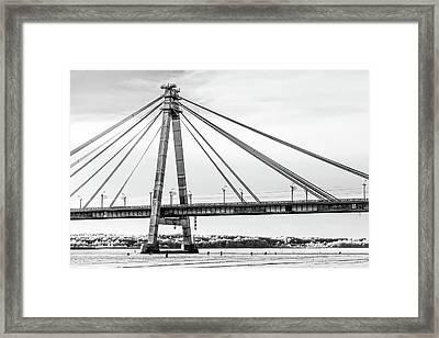 Hockey Under The Bridge Framed Print by Ant Rozetsky