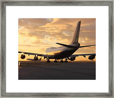 Holding Short Framed Print