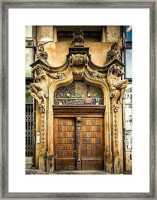 Holding Up The Doorway Framed Print