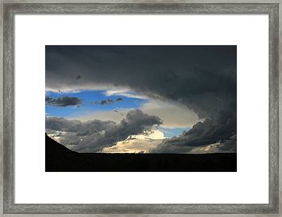 Hole In The Storm Framed Print