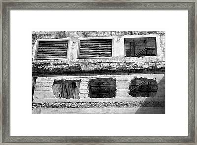 Holes In The Wall Framed Print by Robert Wilder Jr