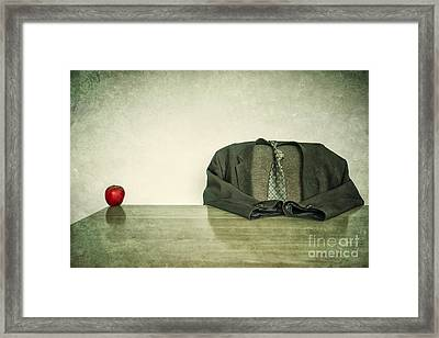 Hollow Man And Red Apple Framed Print