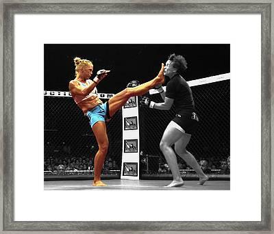 Holly Holm Kicking Jan Finney Framed Print by Brian Reaves