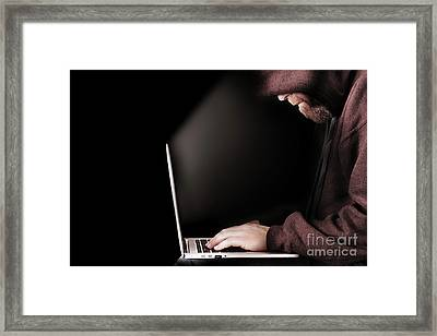 Hooded Computer Hacker Using Laptop Framed Print