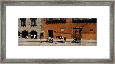 Horse Standing Between Two Motorcycles Framed Print by Panoramic Images