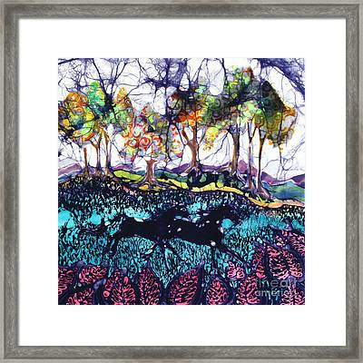Horses Running Below Hills Framed Print