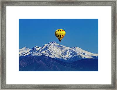 Hot Air Balloon Above The Rockies Framed Print by Teri Virbickis