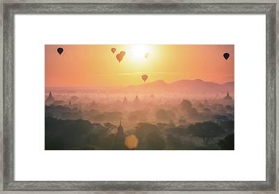 Hot Air Balloon Over Plain And Pagoda Of Bagan In Misty Morning Framed Print by Anek Suwannaphoom