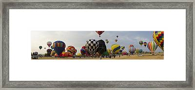 Hot Air Balloon Races Framed Print by Rick Mosher