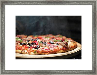 Hot Steaming Pizza In Oven Framed Print by Susan Schmitz