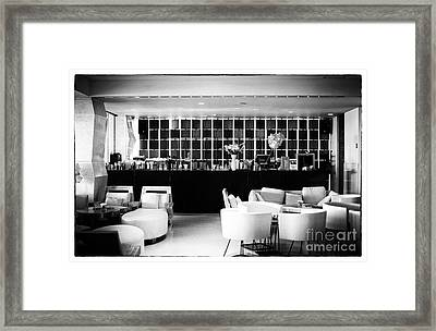 Hotel Bar Framed Print by John Rizzuto