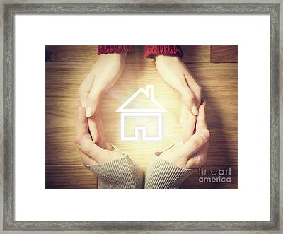 House Symbol Inside Hands Circle. Concept Of Home Insurance Framed Print by Michal Bednarek