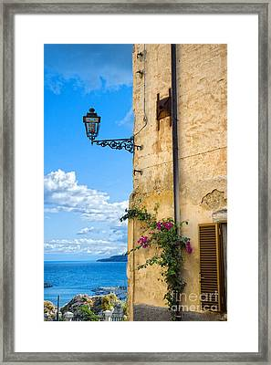 House With Bougainvillea Street Lamp And Distant Sea Framed Print