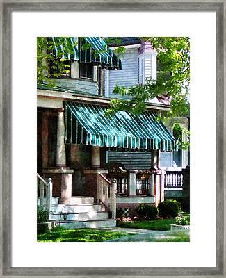 House With Green Striped Awnings Framed Print by Susan Savad