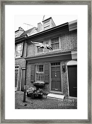 house with old british flag on elfreths alley in the old city of Philadelphia USA Framed Print