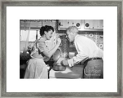 Housewife Having Husband Taste Food Framed Print by Debrocke/ClassicStock