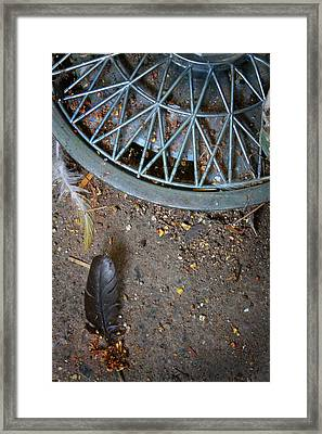 Hubcap And Feather Framed Print by Amanda Wimsatt