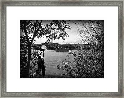 Huck Finn Type Walking On River  Framed Print by Randall Branham