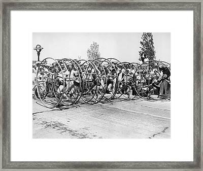 Human Hoop Race In La Framed Print by Underwood Archives