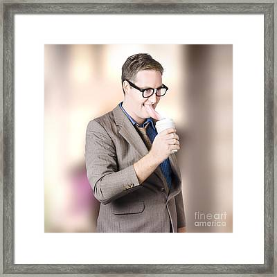Humorous Businessman Licking Top Of Coffee Cup Framed Print by Jorgo Photography - Wall Art Gallery