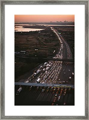 Hundreds Of Cars Line Up To Pay A Toll Framed Print