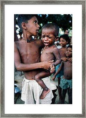 Hunger In India Framed Print by Carl Purcell