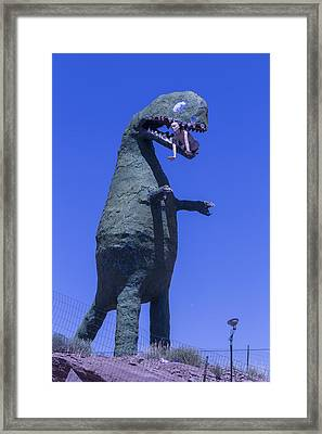 Hungry Dinosaur Framed Print by Garry Gay