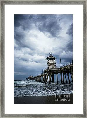 Huntington Beach Pier With Storm Clouds Framed Print by Paul Velgos