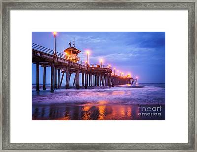 Huntington Pier Morning Storm Clouds Framed Print by Paul Velgos