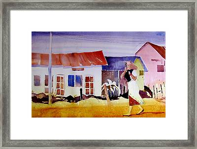 Hurrying In Tanzania Framed Print